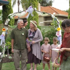 Mature couple hold a commitment ceremony in their home garden in Perth, Western Australia