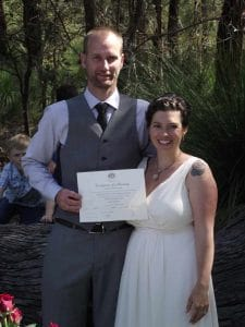 Newly wedded couple holding marriage certificate presented by Perth celebrant Ishara