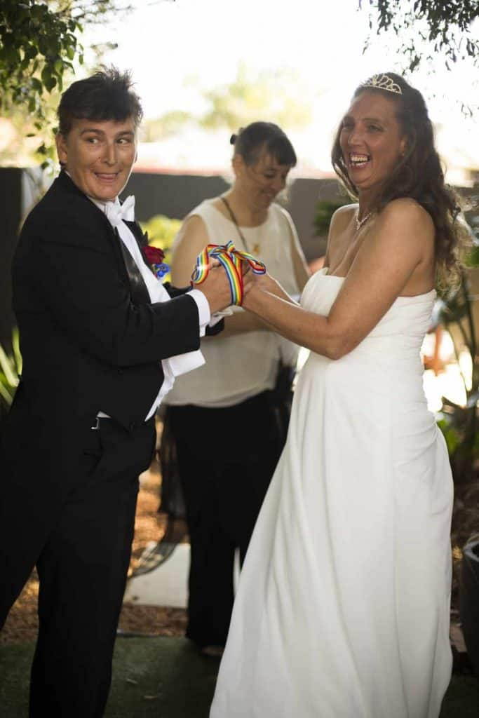 Two elegantly dressed lesbian brides celebrate their union with a ceremony by Perth celebrant Ishara