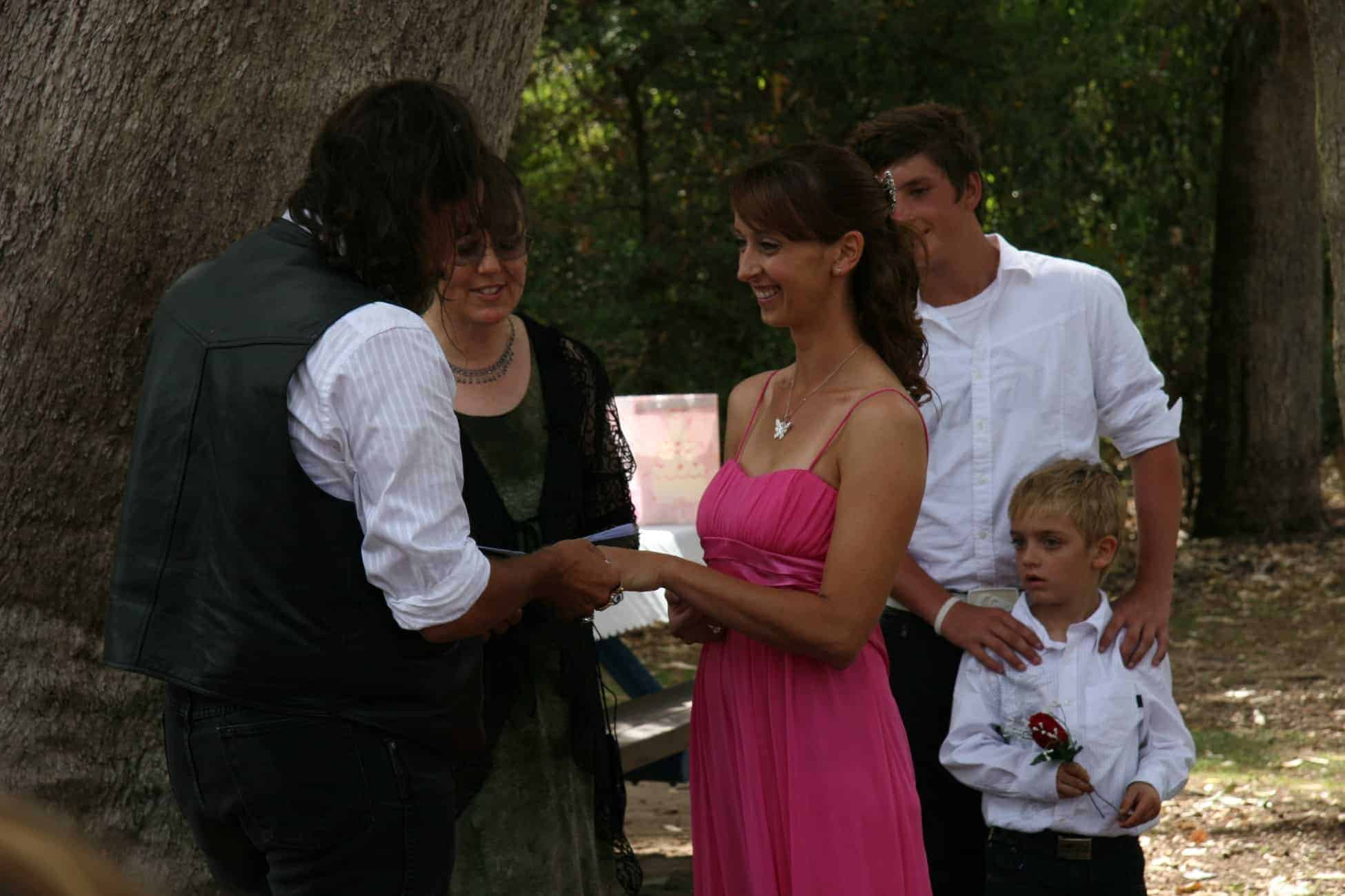 Couple with child getting married in a park with Perth marriage celebrant Ishara
