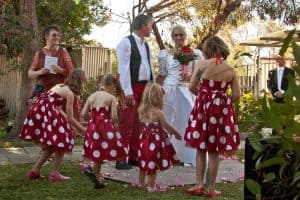 Bride and groom encircled with petals - a romantic garden wedding with Perth celebrant Ishara