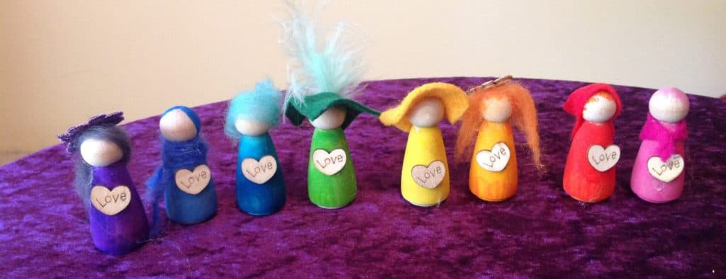 Roll of small blessing circle dolls in the colours of the rainbow