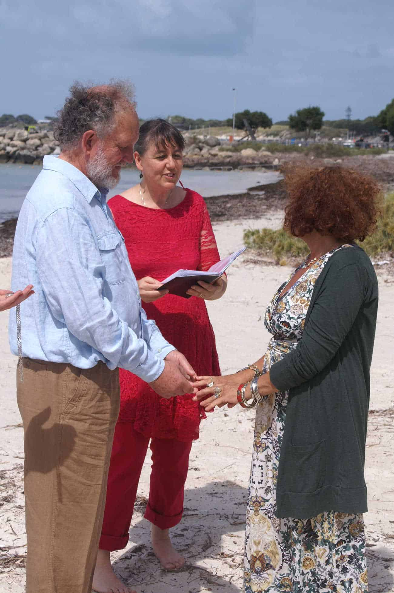 Mature couple get married on a Rottnest Beach with a ceremony by Perth celebrant Ishara de Garis